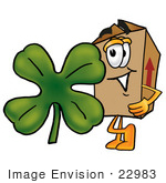 #22983 Clip Art Graphic Of A Cardboard Shipping Box Cartoon Character With A Green Four Leaf Clover On St Paddy'S Or St Patricks Day