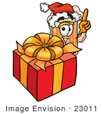 #23011 Clip Art Graphic Of A Frothy Mug Of Beer Or Soda Cartoon Character Standing By A Christmas Present
