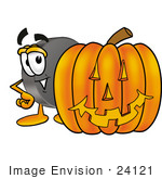 #24121 Clip Art Graphic of an Ice Hockey Puck Cartoon Character With a Carved Halloween Pumpkin by toons4biz
