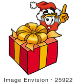#25922 Clip Art Graphic Of A Red Paintbrush With Yellow Paint Cartoon Character Standing By A Christmas Present