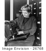 #26768 Stock Photography Of Frances Benjamin Johnston Holding And Looking At Her Camera