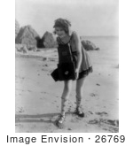#26769 Stock Photography Of A Female Actress Myrtle Lind Holding A Camera On A Beach In 1919