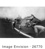 #26770 Stock Photography of a Man Riding a Zebra and Jumping Over a Fence in East Africa by JVPD