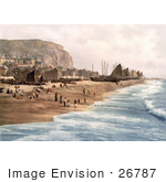 #26787 Stock Photography Of Blue Ocean Waves Rolling Towards Ships Net Shops And People On The Beach At The Fish Market On The East Cliff In Hastings East Sussex England Uk