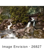 #26827 Stock Photography Of A Footbridge Spanning The Upper Falls Waterfalls In Glen Lyn Gorge In Lynton And Lynmouth Devon England Uk