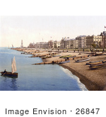 #26847 Stock Photography Of A Man Rowing A Boat Near A Beach With Boats Lined Up On The Shore And Waterfront Buildings In Herne Bay Kent South East England