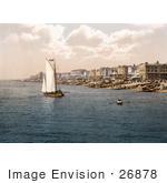 #26878 Stock Photography Of A Sailboat By Bathing Machines And People On The Beach In Worthing West Sussex England Uk