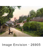 #26905 Stock Photography Of A Woman Walking Along The Road And A Man Pushing A Wheelbarrow Near The Castle Tower In Ross-On-Wye Herefordshire England Uk