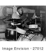 #27012 Stock Photography of a Young African American Man Playing The Drums And Entertaining In A Juke Joint In Memphis, Tennessee In 1939 by JVPD
