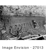 #27013 Stock Photography Of The Interior Of A Mine With A Miner Inserting Water Tubes In The Side Of The Shaft In Nome Alaska 1909