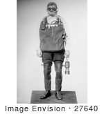 #27640 Stock Photo Of A Male Mine Rescuer In A Mask And Safety Gear Carrying A Lantern