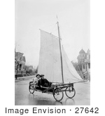 #27642 Stock Photo Of Two Men Pedaling Down The Street In Brooklyn New York On A Sail Wagon Also Known As A Sand Yacht Or Land Yacht