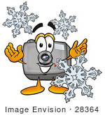 #28364 Clip Art Graphic Of A Flash Camera Cartoon Character Surrounded By Snowflakes In Winter