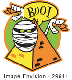 #29611 Royalty-Free Cartoon Clip Art Of A White Mummy With Green Glowing Eyes Peeking Out Of A Pyramid And Screaming &Quot;Boo!&Quot;