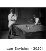 #30201 Historical Black And White Stock Photo Of A Woman Leaning On A Cue Stick And Sitting On The Edge Of A Pool Table While Watching Her Friend Play Billiards In 1903