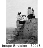 #30218 Stock Photo Of The Backs Of Four Hopi Native American Women Seated On A Roof At The Top Of Stairs On A Walpi Pueblo 1904