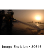 #30646 Stock Photo Of United States Navy Sailors Spraying Down The Flight Deck Of The Uss Harry S Truman (Cvn 75) Aircraft Carrier With A Fire Hose At Sunset