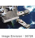#30728 Stock Photo Of Tugboats Beside An Aircraft Carrier With Military Jets On Board In Guam