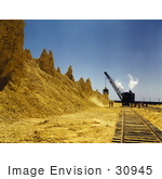 #30945 Stock Photo Of A Dragline Excavator On The Railroad Tracks Loading Boxcars Full Of Sulphur At A Vat At The Freeport Sulphur Company In Hoskins Mound Texas