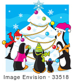 #33518 Christmas Clipart Of A Family Of Penguins Having A Party And Decorating A Snow Covered Tree