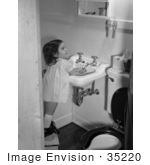 #35220 Stock Photo of a Little Girl Standing On A Stool And Washing Her Hands After Using The Toilet by JVPD