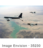 #35230 Stock Photo of a U.S. Navy F/A-18F Super Hornet Aircraft Flying Near A U.S. Air Force KC-135R Stratotanker Refueling A U.S. Navy Ea-6b Prowler Over Helmand, Afghanistan by JVPD