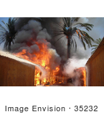 #35232 Stock Photo Of Fire Consuming Trees And Buildings Of A Marine Compound At The Entrance Of Fallujah Iraq June 25th 2008