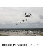 #35242 Stock Photo of a V-22 Osprey, CH-53E Super Stallion Helicopter, CH-46 Sea Knight Helicopter, UH-1N Huey Aircraft, And an AH-1 Cobra Aircraft Performing a Formation Flight by JVPD