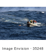 #35248 Stock Photo Of US Navy Sailors Using A Rigid Hull Inflatable Boat To Approach A Practice Dummy During A Man Overboard Drill While Under Way In The Pacific Ocean