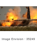 #35249 Stock Photo Of The US Air Force Detonating Explosives Attached To The Wings Of A C-130 Hercules Aircraft At Sather Air Base In Iraq