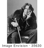 #35630 Stock Photo of Oscar Wilde In A Coat, Sitting In A Chair With His Hand Touching His Face, Holding A Walking Stick by JVPD