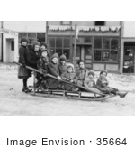 #35664 Stock Photo Of A Group Of Children Posing On A Sled In The Middle Of A Village Street In Seward Alaska