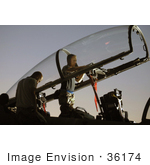 #36174 Stock Photo Of A Man Inspecting The Cockpit Of An F-15e Eagle Aircraft