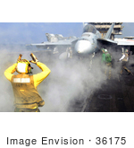 #36175 Stock Photo Of A US Navy Aviation Boatswain'S Mate Directing An F/A-18 Super Hornet Aircraft