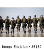 #36182 Stock Photo Of A Line Of Soldiers Walking Away Towards The Surf On A Beach