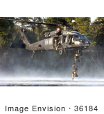 #36184 Stock Photo Of US Air Force Pararescuemen Climbing A Ladder To A US Army Mh-60 Black Hawk Helicopter