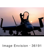 #36191 Stock Photo Of A Silhouetted F/A-18c Hornet And Person At Sunset