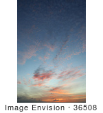 #36508 Stock Photo Of A Hawaiian Sunset Sky Of Pink And Orange Wispy And Spotted Clouds Over Blue