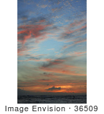 #36509 Stock Photo Of Orange And Pink Wispy Clouds Scattered At Sunset Over The Ocean Poipu Kauai Hawaii