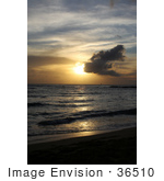 #36510 Stock Photo Of A Sailboat Far In The Distance On The Ocean At Sunset Seen From Poipu Kauai Hawaii