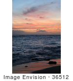 #36512 Stock Photo Of A Dusk Sky Of Pink Clouds Over The Ocean Reflecting Off Of The Wet Sand Poipu Kauai Hawaii