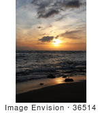#36514 Stock Photo Of An Orange Sunset With Scattered Clouds Over The Ocean With Light Reflecting On The Wet Sand And Surf Poipu Kauai Hawaii