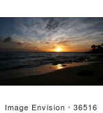 #36516 Stock Photo Of An Orange Light From A Sunset Reflecting Off Of The Wet Sand And Waves On The Pacific Ocean Poipu Kauai Hawaii