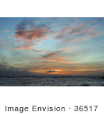#36517 Stock Photo Of Scattered Orange And Pink Wispy Clouds At Sunset Over The Ocean Poipu Kauai Hawaii