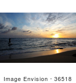 #36518 Stock Photo Of A Silhouetted Stand Up Paddle Surfer Coming To Shore At Sunset In Poipu Kauai Hawaii
