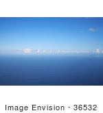 #36532 Stock Photo Of A Seascape Of Blue Rippling Waters Of The Pacific Ocean With Puffy White Clouds And Blue Skies