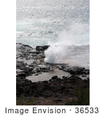 #36533 Stock Photo Of The Blowhole Of Spouting Horn Spraying Water Against A Backdrop Of The Pacific Ocean Poipu Kauai Hawaii
