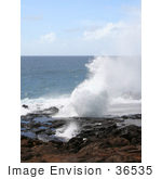#36535 Stock Photo Of The Blowhole Spouting Horn Spurting Up Water By The Pacific Ocean Poipu Kauai Hawaii