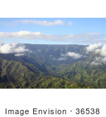 #36538 Stock Photo Of An Aerial View Of The Valley Leading To The Heart Of Mount Waialeale With A Green Landscape And Puffy White Clouds