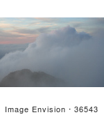 #36543 Stock Photo Of A Foggy Sunset Over Mountains In Kauai Hawaii